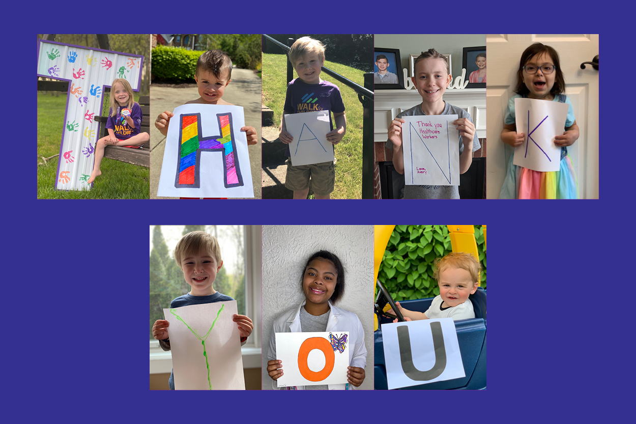 Smiling children holding letters that spell Thank You